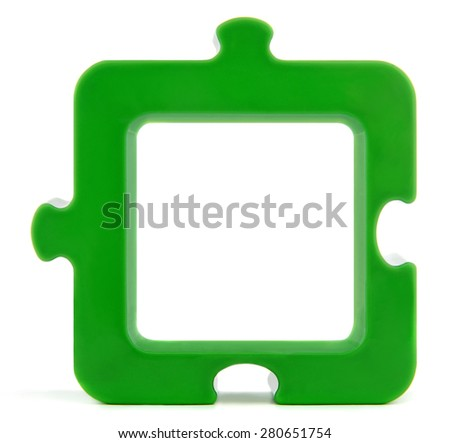 Green plastic puzzle as a picture frame, isolated on white.Studio shot. - stock photo