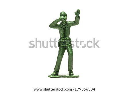 Green plastic soldiers on white background searching