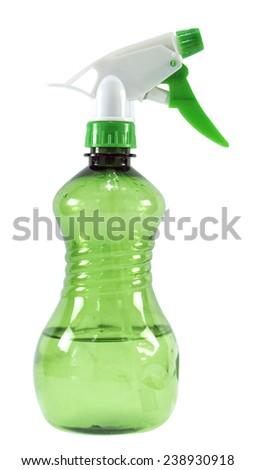 Green plastic spray bottle isolated on white background - stock photo