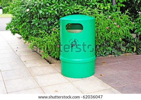 Green Plastic Waste Container In The Park - stock photo