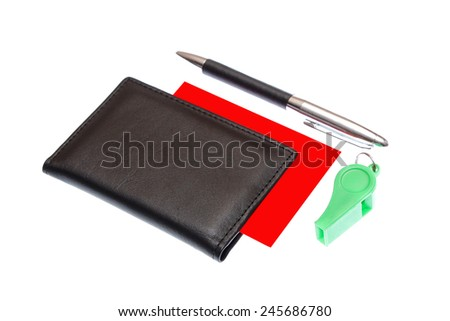green plastic whistle and red card on white background - stock photo