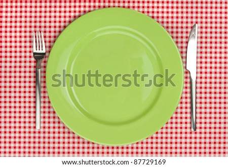 Green plate with fork and knife