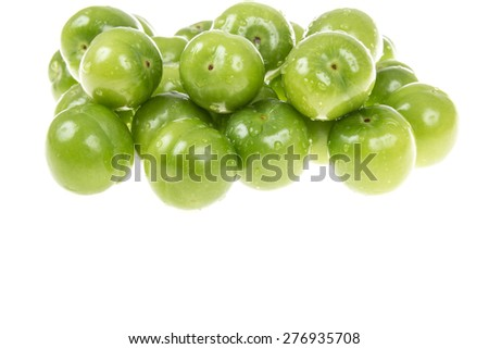 green plums on white - stock photo
