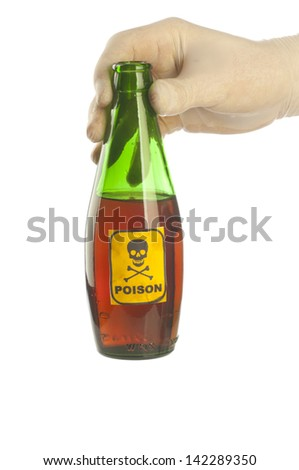 Green poison bottle with skull and crossbones on hand - stock photo