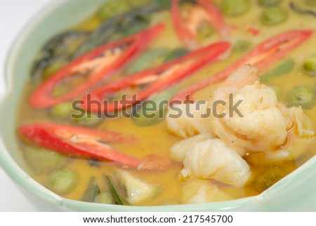Green pork Curry on green leaf , Thai cuisine,Thai shrimp curry in green bowl,Shrimp, Beef or Chicken Curry - stock photo