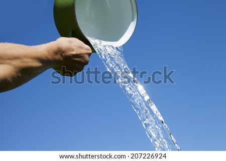 Green pot and pouring water.