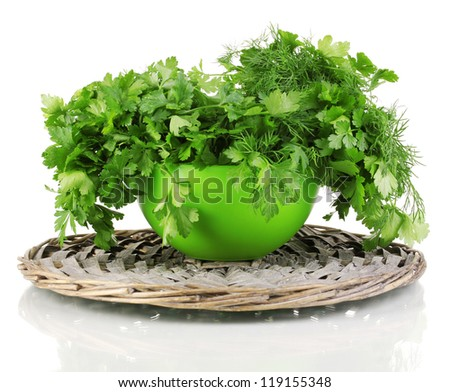 Green pot with parsley and dill on wicker cradle isolated on white - stock photo