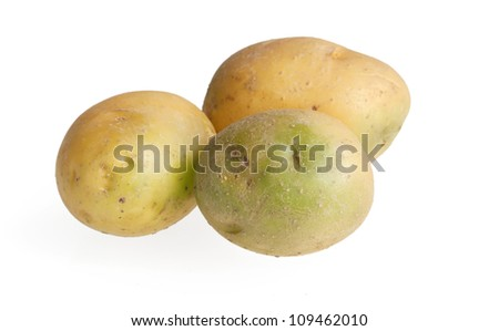 Green potatoes containing solanine are poisonous - stock photo