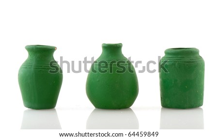 Green pottery jars in a row isolated over white
