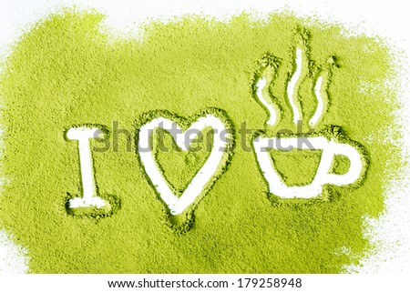 green powder forming heart and tea cup shape surface close up isolated on white background - stock photo