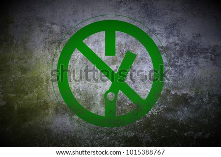 green prohibition stop symbol sign painted on old mossy concrete wall texture background