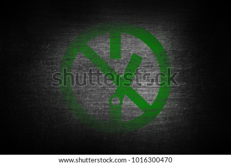 green prohibition stop symbol sign painted on scratched metal surface texture background