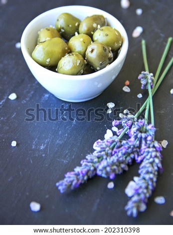 green Provencal olives marinated in olive oil and spices - stock photo