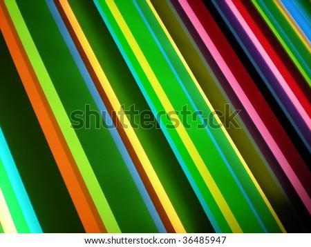Green, purple and yellow striped pattern background - stylish bright colors - stock photo