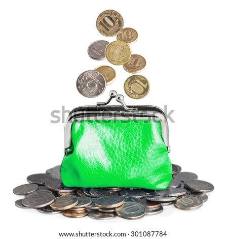 Green purse with falling coins. Isolated on white background - stock photo