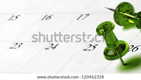green pushpin pointing on the number 26 of a calendar with room for text at the left side of the image
