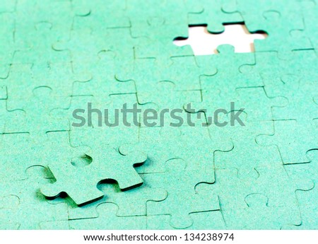 Green puzzle with missing piece - stock photo