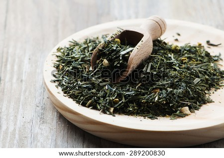 Green raw tea on the wooden table, selective focus - stock photo