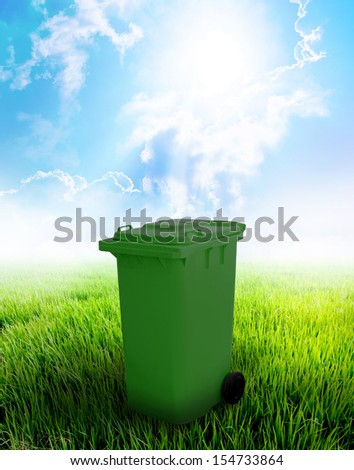 Green Recycle Bin With Landscape Background.
