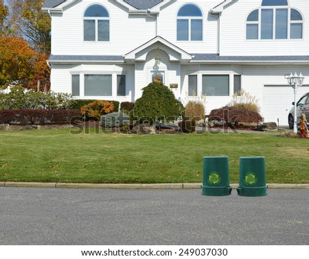 Green recycle, reuse, reduce, trash container closeup of suburban mcmansion autumn day residential neighborhood USA - stock photo