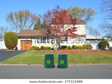 Green recycle, reuse, reduce, trash containers curbside Suburban High Ranch style home Autumn Clear Blue Sky Day Residential Neighborhood USA - stock photo