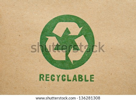 Green recycle symbol on cardboard - stock photo
