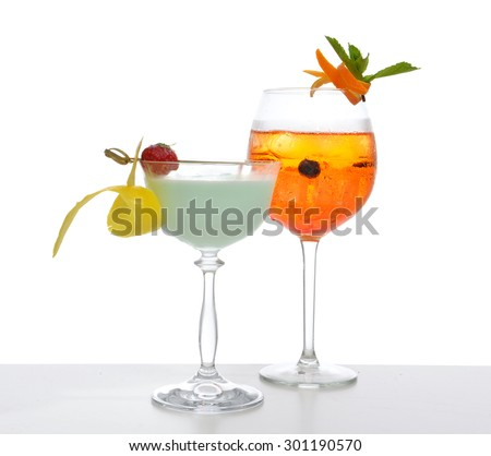 Green red orange alcohol margarita martini mojito cocktails collage composition with lemon and mint in cocktail glasses isolated on a white background - stock photo