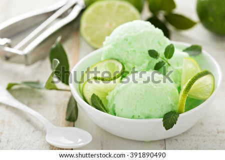 Green refreshing lime ice cream in white bowl - stock photo