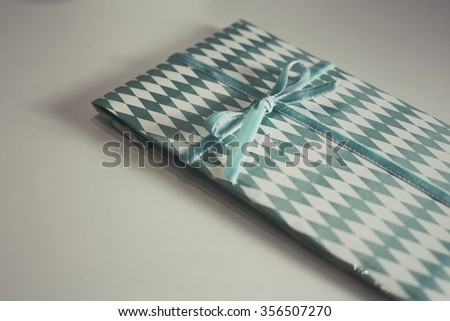 Green rhombus wrap paper gift on a white background