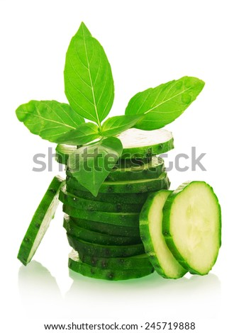 Green ripe Cucumber slices with basil leaves - stock photo