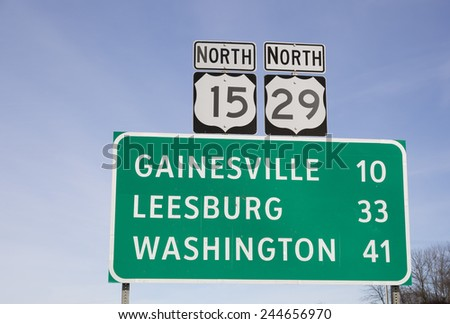 Green road sign in Northern Virginia on Route 29 in Warrenton, VA - stock photo