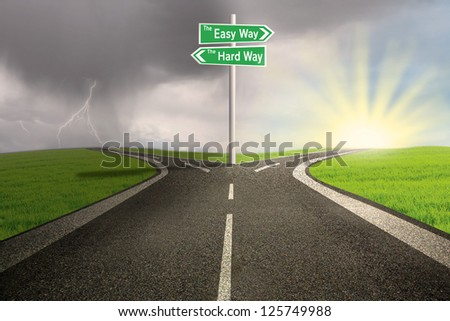 Green road sign of easy vs hard way on toll/highway - stock photo