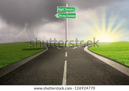 Green road sign of right vs wrong decision on highway with thunder storm background - stock photo