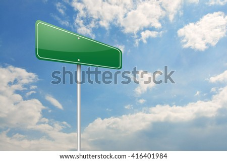 Green road sign over the blue sky  - stock photo