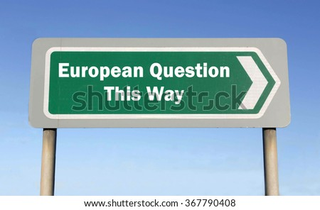 Green road sign with the message of an European Question This Way concept against a blue sky background