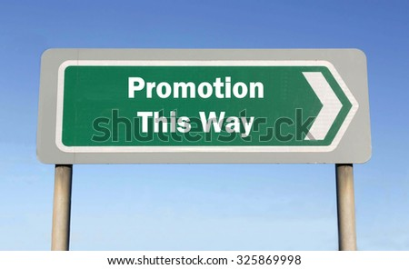 Green road sign with the message of Promotion This Way concept against a blue sky background