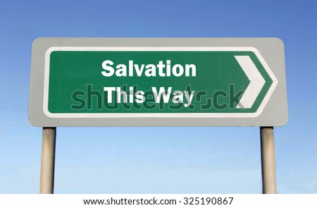 Green road sign with the message of Salvation This Way concept against a blue sky background