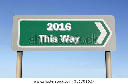 Green road sign with the message of 2016 This Way concept against a blue sky background