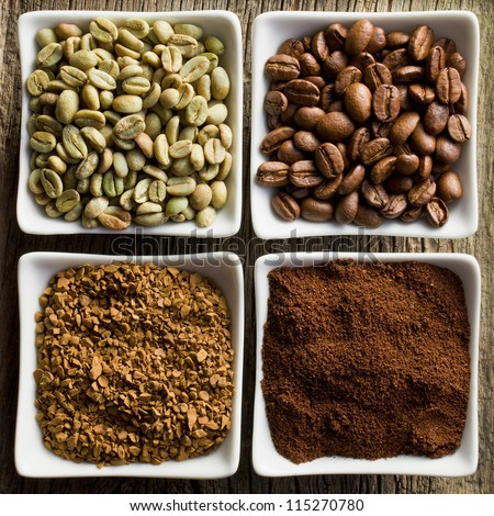 green, roasted, ground and instant coffee in ceramic bowls - stock photo
