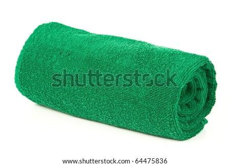 Green rolled up towel over white background - stock photo