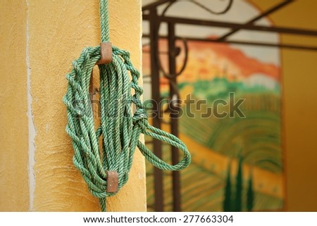 Green rope was tied to a pole. - stock photo