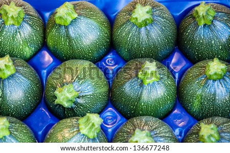 Green round  zucchini  at farmers market in Paris. - stock photo