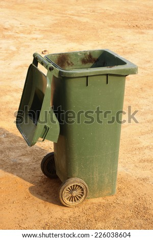 Green rubbish bin open lid at outdoor - stock photo