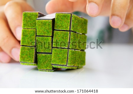 green rubik's cube concept  - stock photo