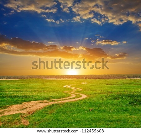 green rural landscape ar the evening - stock photo