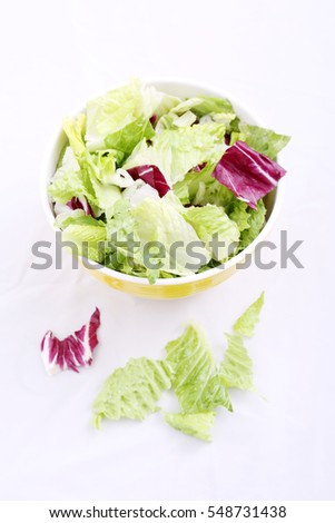 Green Salad in a yellow bowl.