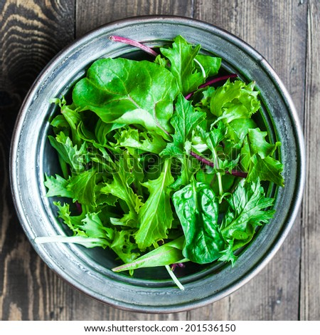 Green salad on rustic background - stock photo