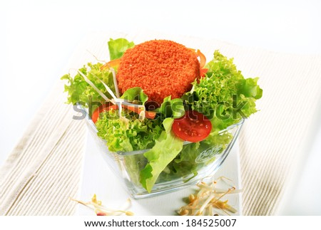 Green salad with fried breaded cheese
