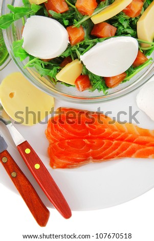 green salad with smoked salmon and bread in transparent bowl