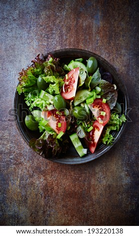 Green Salad with Tomato and Olives - stock photo